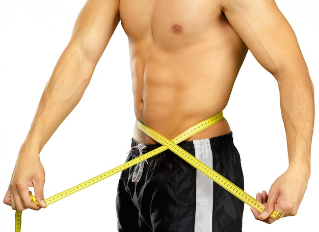 Close up photo of sportsman measuring waist with tape isolated on white Premium Photo