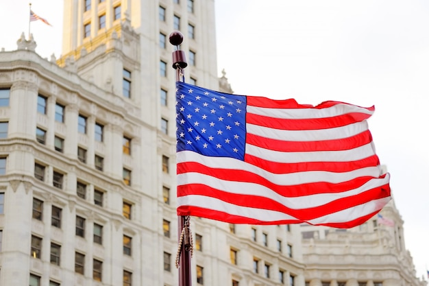 Close up photo of usa flag with skyscraper on background Premium Photo