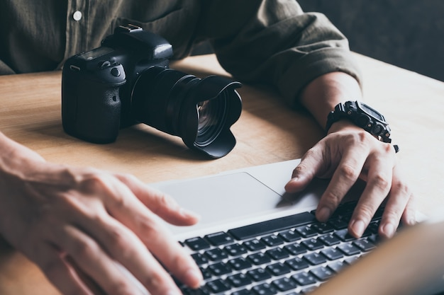 Close up of photographer editing his images on laptop. Premium Photo