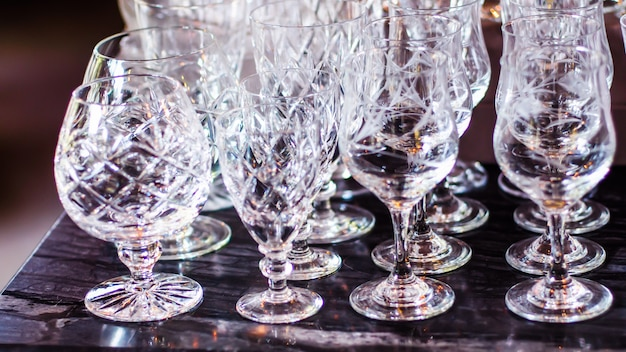Close up picture of empty crystal wine glasses in restaurant Premium Photo