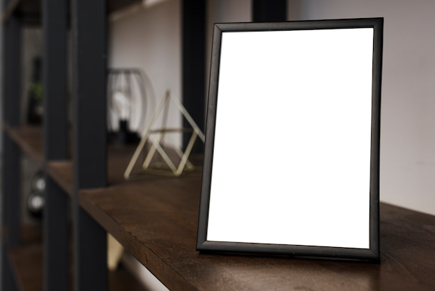Close-up picture frame on bookshelf Free Photo