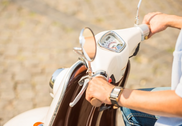 Close-up picture of a man riding on scooter outdoors. Premium Photo