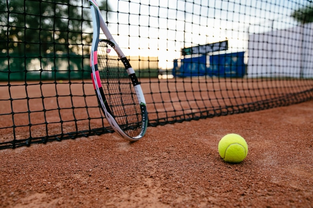 Close Up Picture Of Tennis Racket And Ball On The Clay Court View