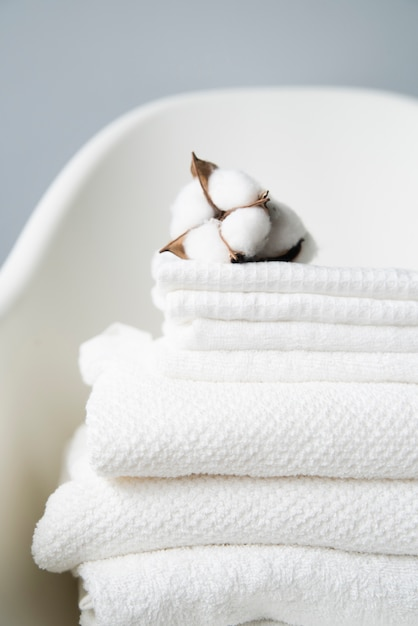 Close-up pile of towels with cotton Premium Photo