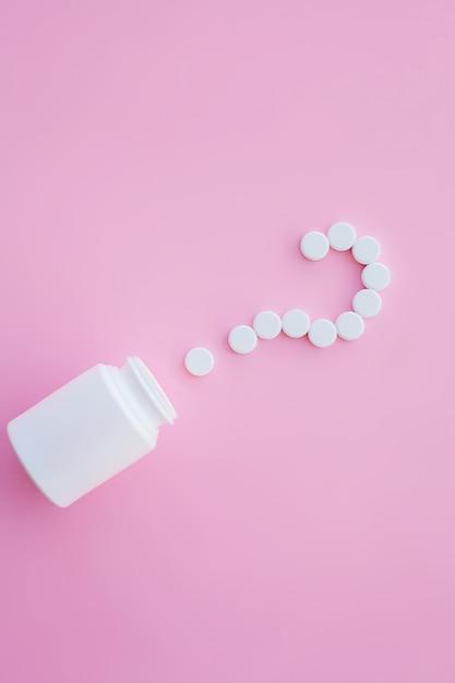 Close up of pills. dietary supplements. variety pills. vitamin capsules on pink Premium Photo
