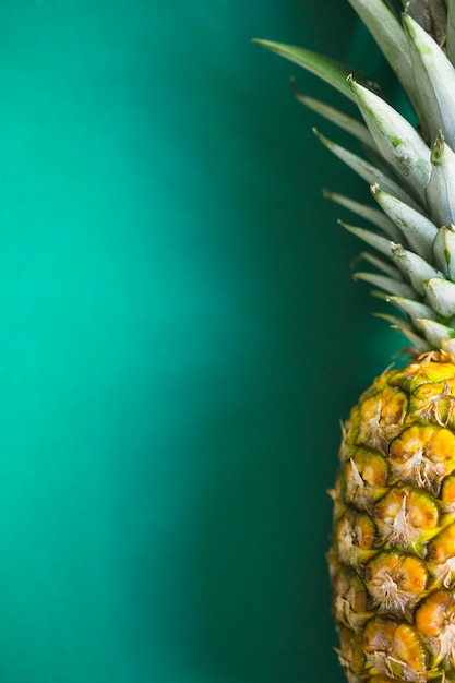 Close-up of pineapple on green background Free Photo