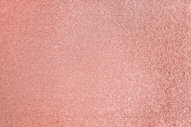 Close up of pink blush glitter textured background Free Photo