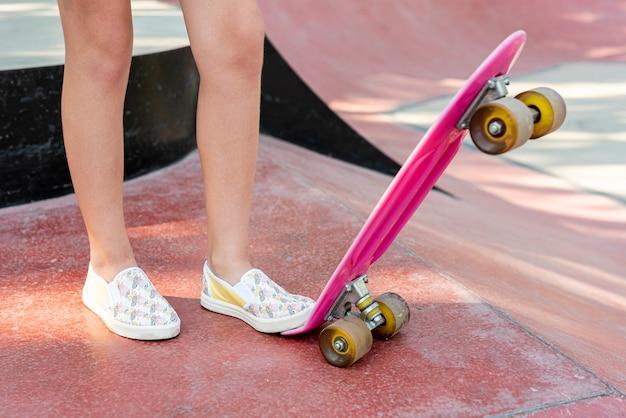 Close-up of pink skateboard Free Photo