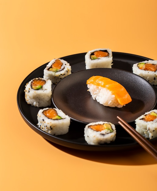 Close up plate of sushi rolls with nigiri Free Photo
