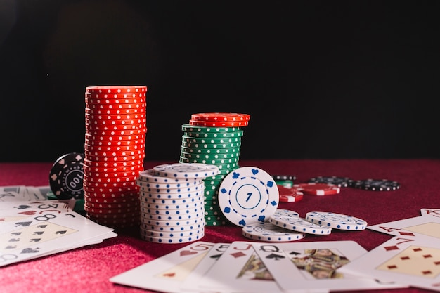 Close-up of poker chips and playing cards Free Photo