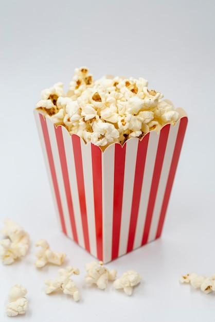 Close-up popcorn box with white background Free Photo