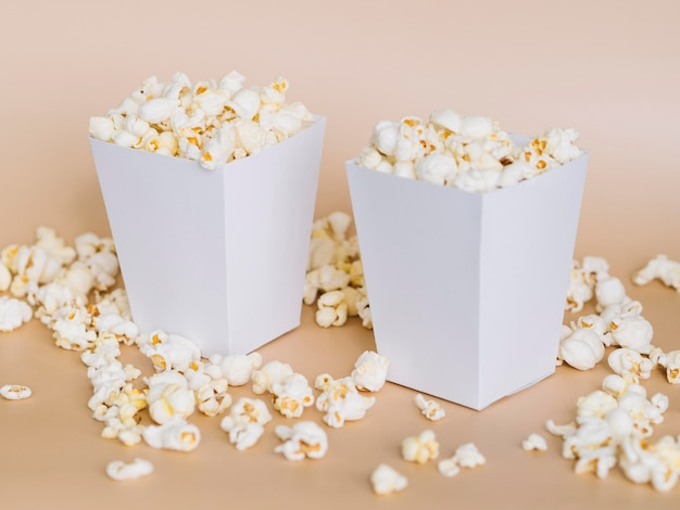 Close-up popcorn boxes on the table Free Photo