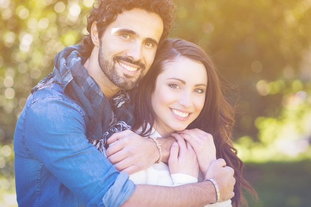 Close up portrait of attractive young couple in love outdoors Premium Photo