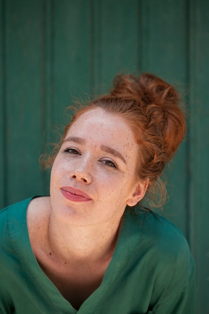 Close-up portrait of beautiful redhead woman Free Photo
