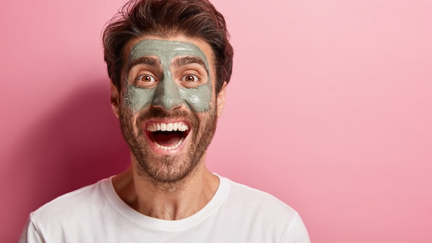 Close up portrait of cheerful male doing his beauty routine Free Photo