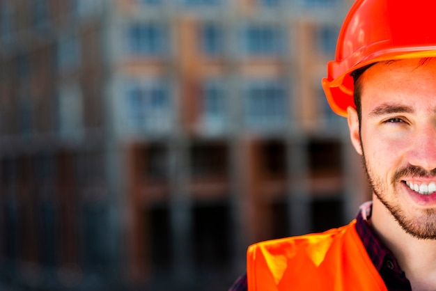 Close up portrait of construction worker looking at camera Free Photo