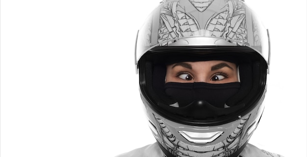 Close up portrait of crazy wowan with extereme life. lady in motorcycle helmet on white background. strabismus young girl. copy space. Free Photo