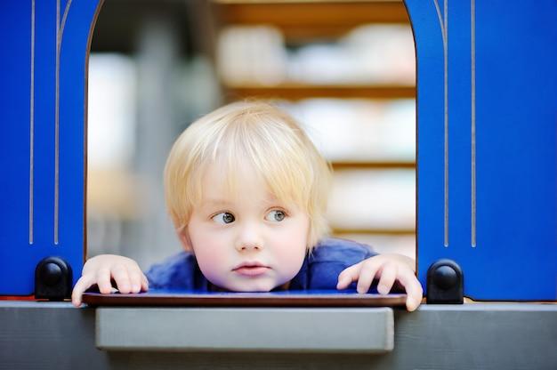 Close-up portrait of cute little boy during game Premium Photo