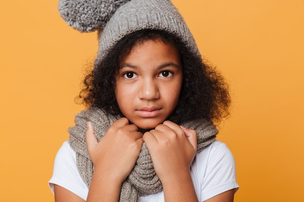 Close up portrait of a frozen afro american girl Free Photo