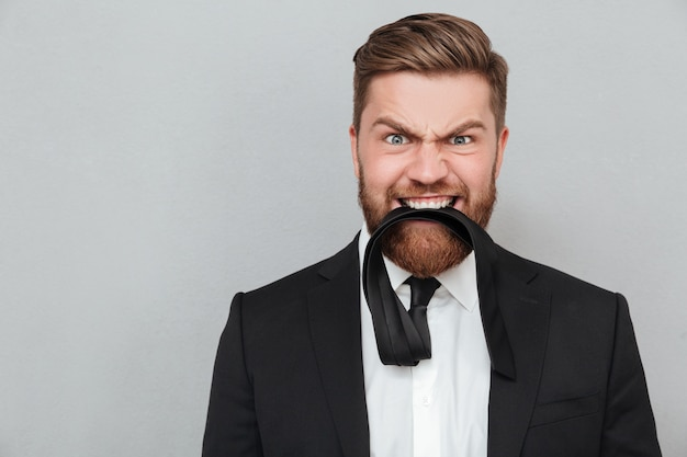 Close up portrait of a funny crazy businessman in suit Free Photo