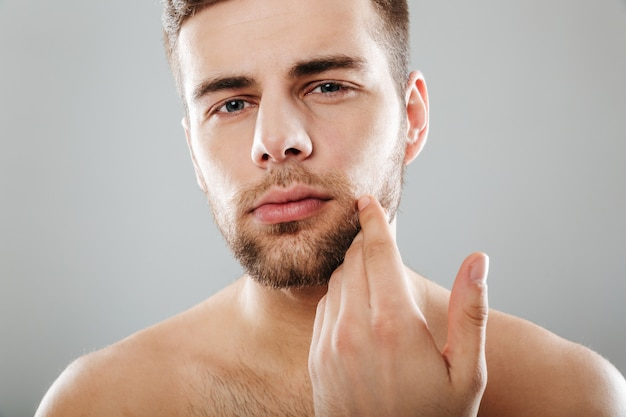 Close up portrait of a handsome bearded man Free Photo
