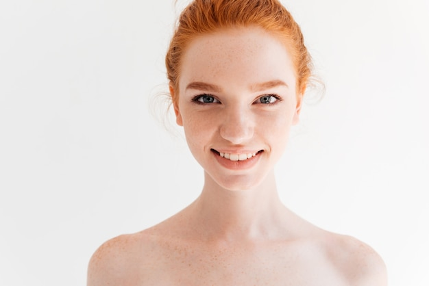 Young Woman With Long Ginger Hair Looking Down Stock Photo