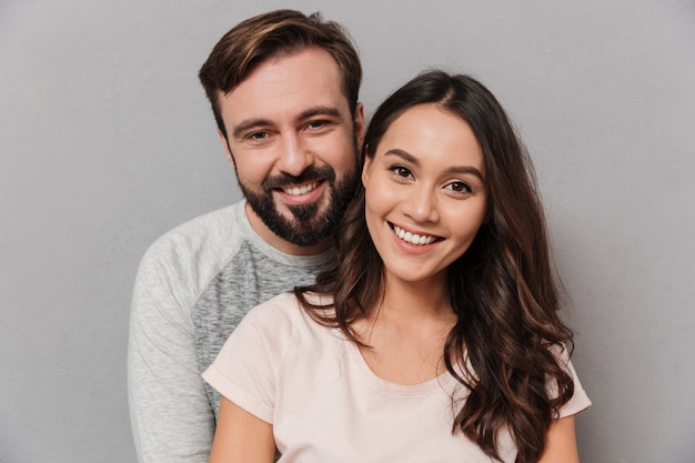 Close up portrait of a happy young couple hugging Premium Photo