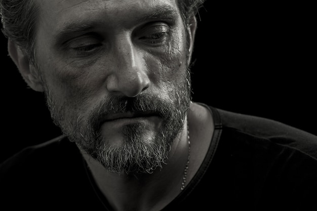 Close up portrait of mid aged man concerned about life difficulties. Premium Photo