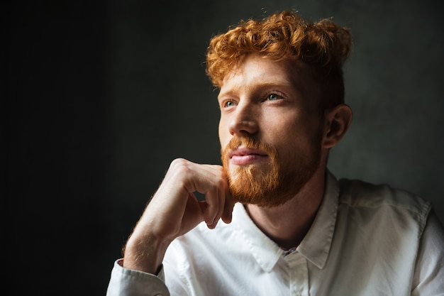 Close up portrait of a pensive young redhead man Free Photo