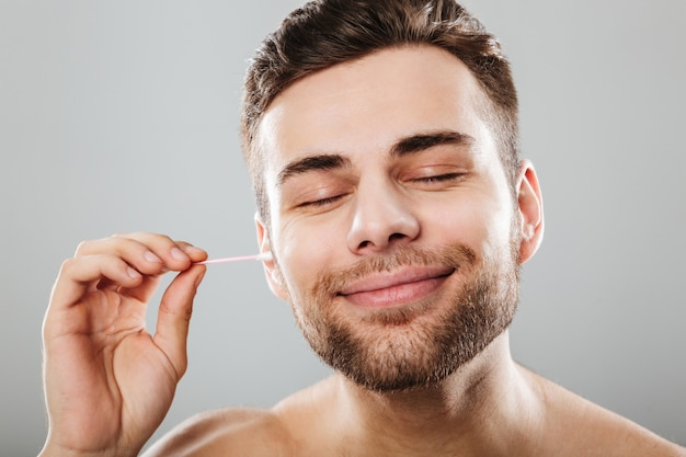 Close up portrait of a satisfied man   Free Photo