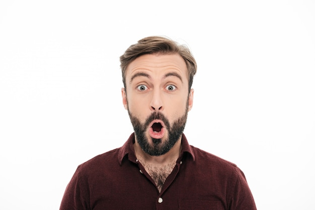 Close up portrait of a surprised young bearded man Free Photo