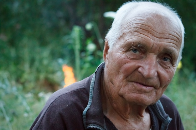 Close-up portrait of a very old man on nature Premium Photo