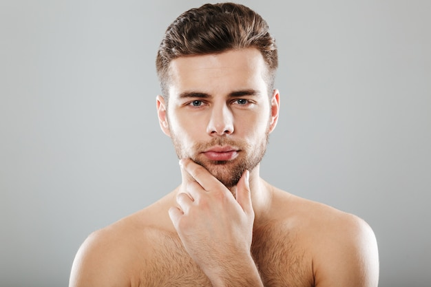Close up portrait of a young bearded man Free Photo