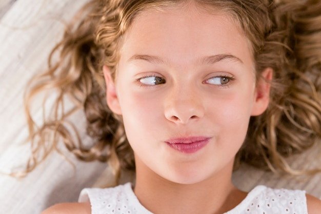 Close Up Portrait Of A Young Beautiful Kid Girl Thinking And