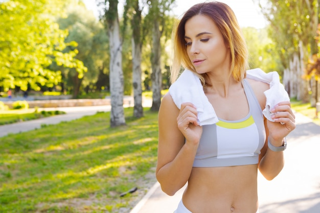 Close-up portrait of young beautiful sport woman in summer park Premium Photo