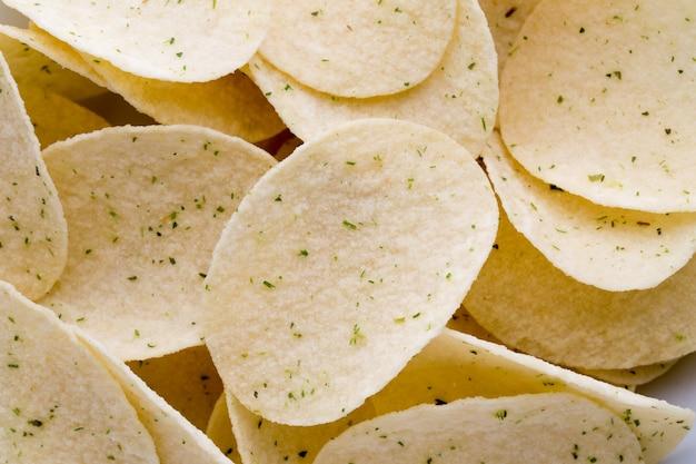 Крупным планом текстуры картофельные чипсы Premium Фотографии