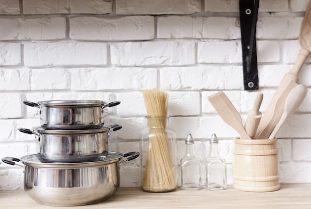 Close-up pots and kitchen utensils on tabletop Free Photo