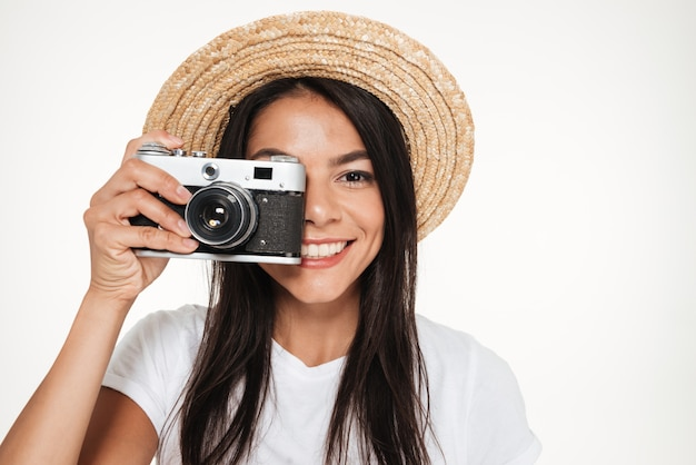 Close up of a pretty young woman in hat standing Free Photo