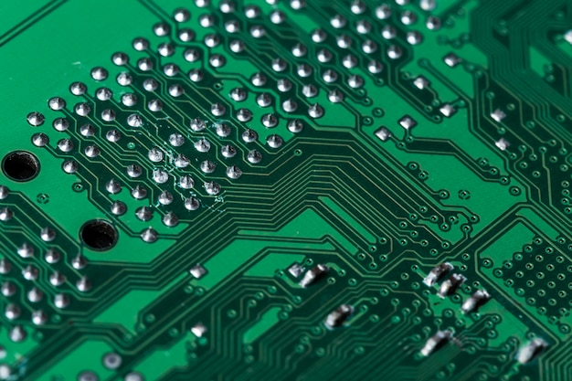 Close up of a printed green computer circuit board Premium Photo