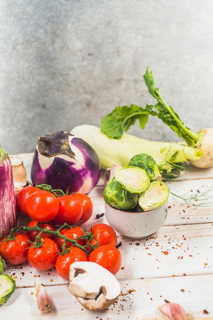 Close-up of raw vegetables on wooden surface Free Photo