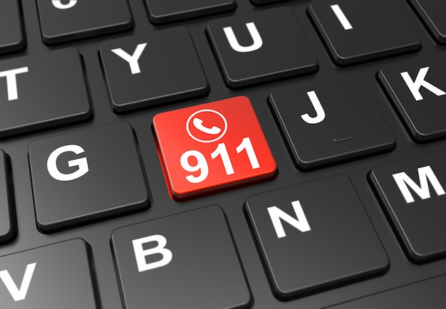 Close up red button with emergency 911 sign on black keyboard Premium Photo