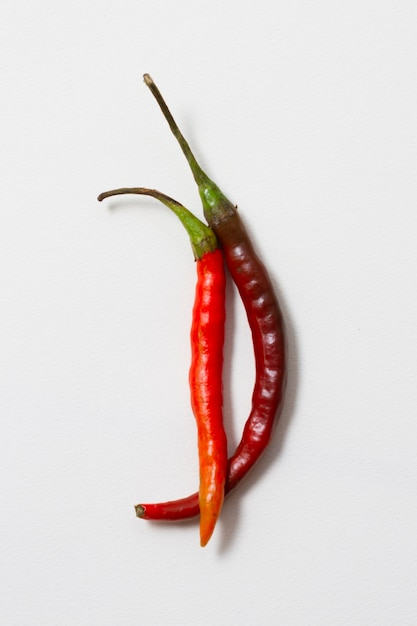 Close-up red hot chili peppers with white background Free Photo