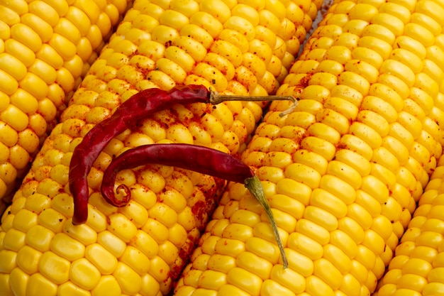 Close-up red hot chilli peppers with corn Free Photo