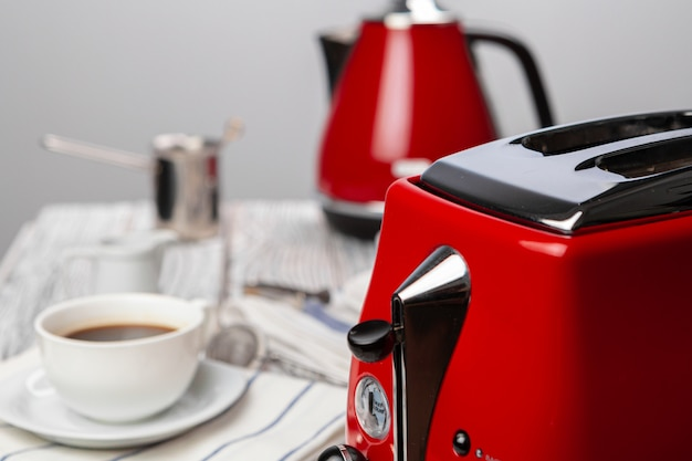 Close up of red kitchen .appliances on kitchen table Premium Photo