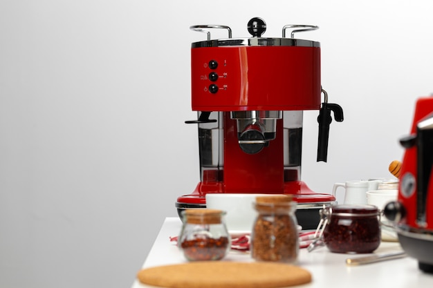 Close up of red kitchen. appliances on kitchen table Premium Photo
