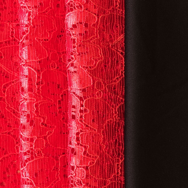 Close-up of red lace and black fabric background Free Photo