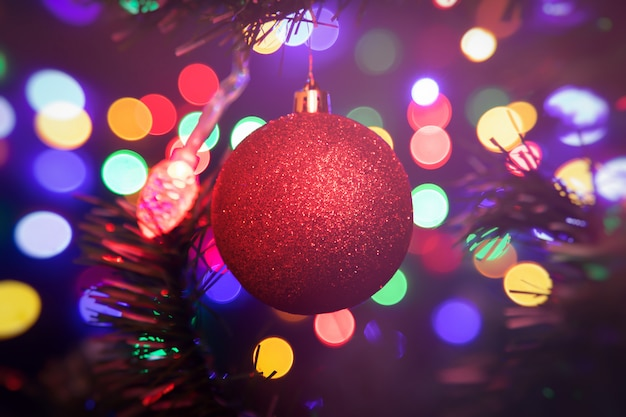 Christmas Ball Garlands.Close Up Of A Red Shiny Christmas Ball Hanging On A