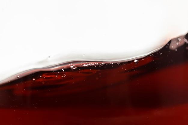 Close-up red wine liquid moving Premium Photo