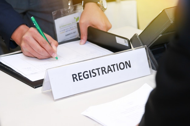 Close-up of registration desk in front of conference center Premium Photo