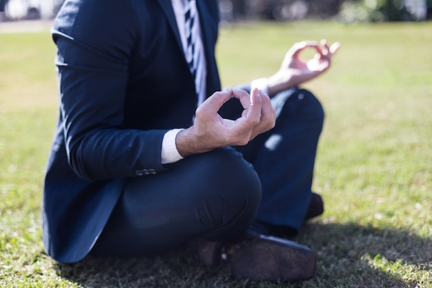 Close-up of relaxed worker in the lotus position Free Photo